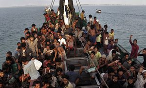 Migrants wait to be rescued off Aceh, Indonesia. About 3,500 migrants have fled by sea in the past month.