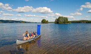 Family canoeing on a lake, Dalsland
