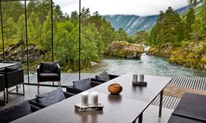 View out to the green, mountainous landscape from the Juvet Landscape Hotel, Valldal, Norway.