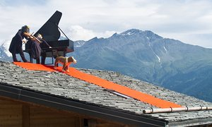 Hitting the high notes: a fiddler on the roof, complete with piano and hound, as part of the Verbier Festival.