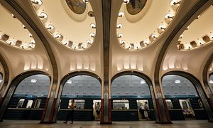 A woman walks on the platform as a train arrives at Mayakovskaya metro station, which was built in 1938, in Moscow August 17, 2013. The Moscow metro was opened in 1935, and carries more passengers daily than the London and New York metro systems combined.