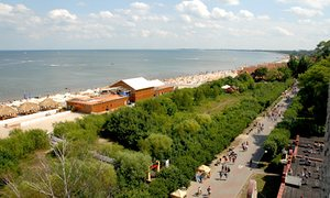 Looking from the lighthouse onto the promenade along the south beach and Baltic Sea shores in the spa Sopot in Pomerania, Poland