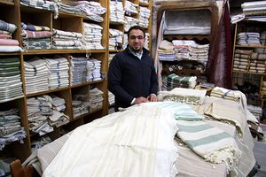 Syria. Hama. Traditonal towels and robes at al-Madani workshop