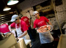 Making a crust … Lombardi's started life as a grocery but the success of its pies led to a dedicated pizzeria being opened